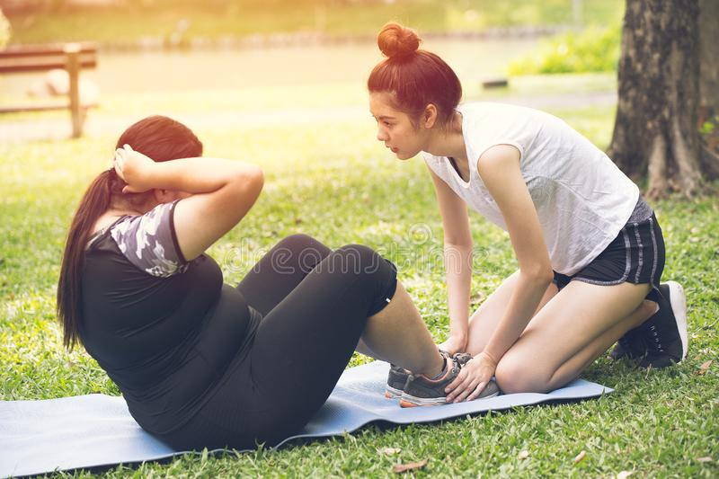 Personal trainer coach teen help training fat girl for diet royalty free stock image