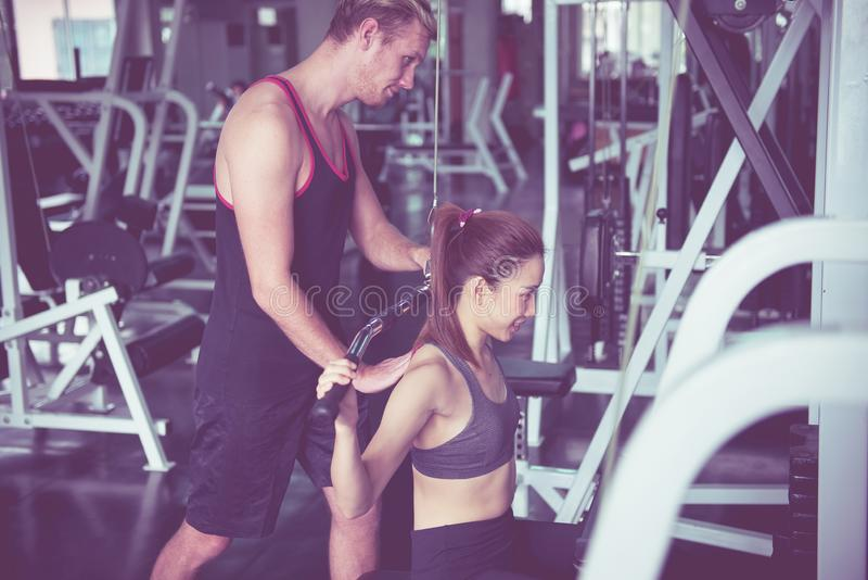 Personal trainer coaching asian woman exercise workout in gym,Concept healthy and lifestyle,Happy and smiling stock photos