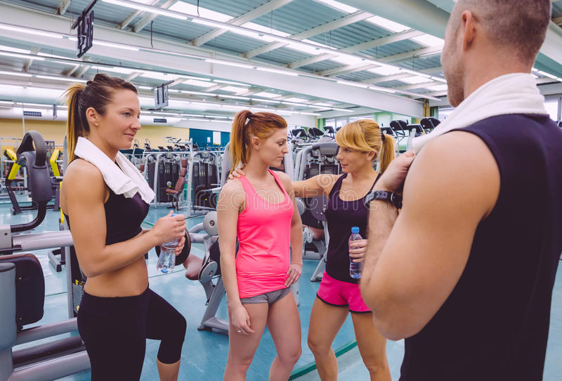 Personal trainer encouraging to sad woman after royalty free stock photography