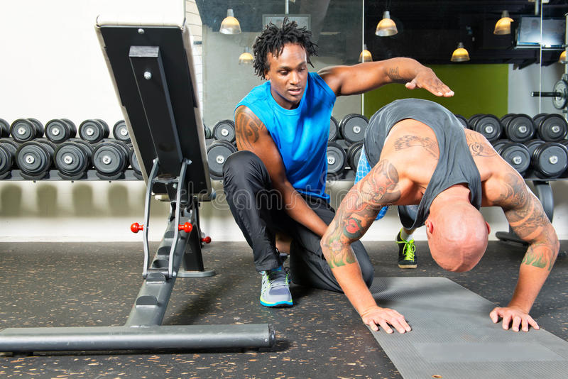 Personal trainer giving instructions royalty free stock images