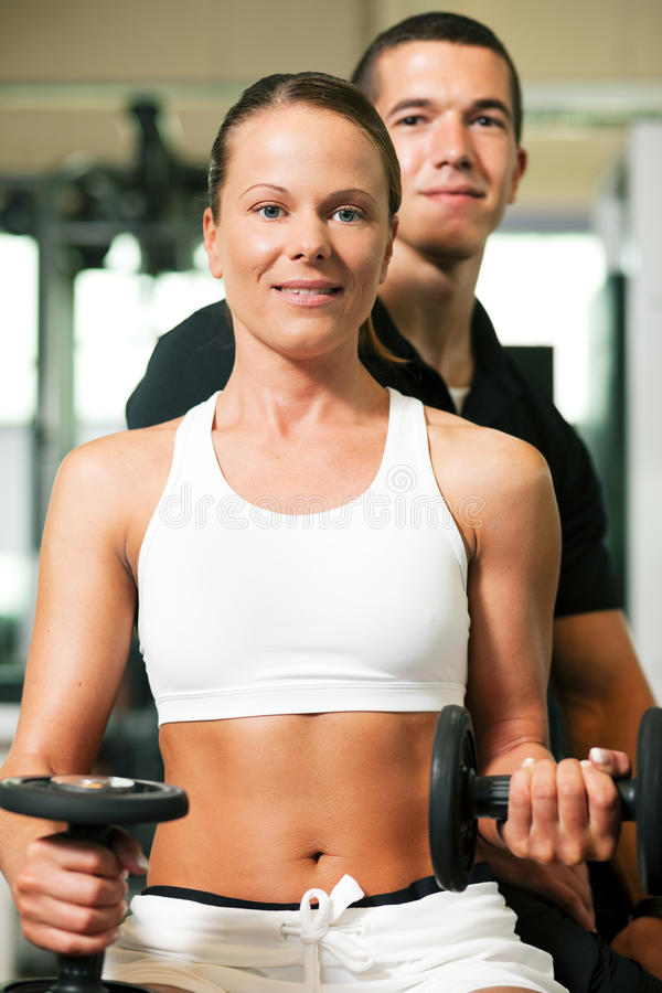 Download Personal Trainer in gym stock photo. Image of club, building - 12335686