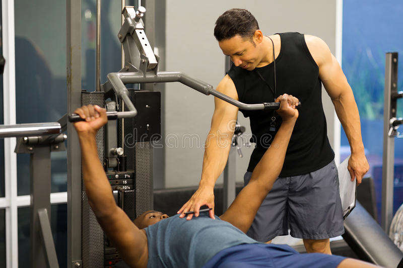 Personal trainer helping client stock photography