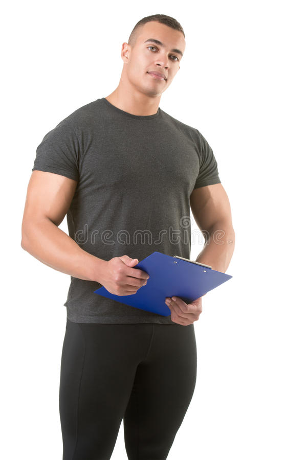 Personal Trainer Holding a Pad royalty free stock photo