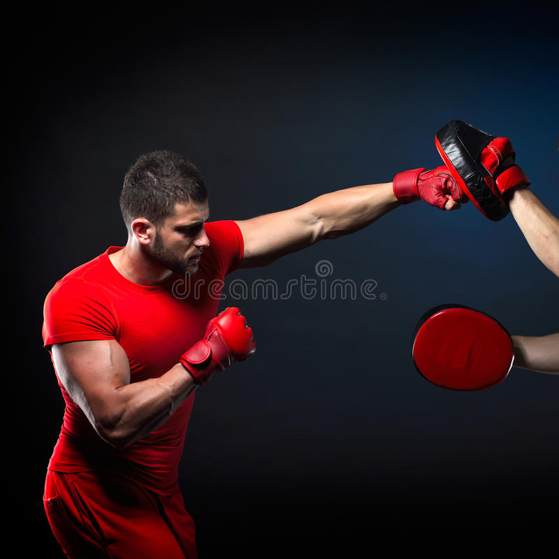Personal trainer man coach and man exercising boxing royalty free stock photo
