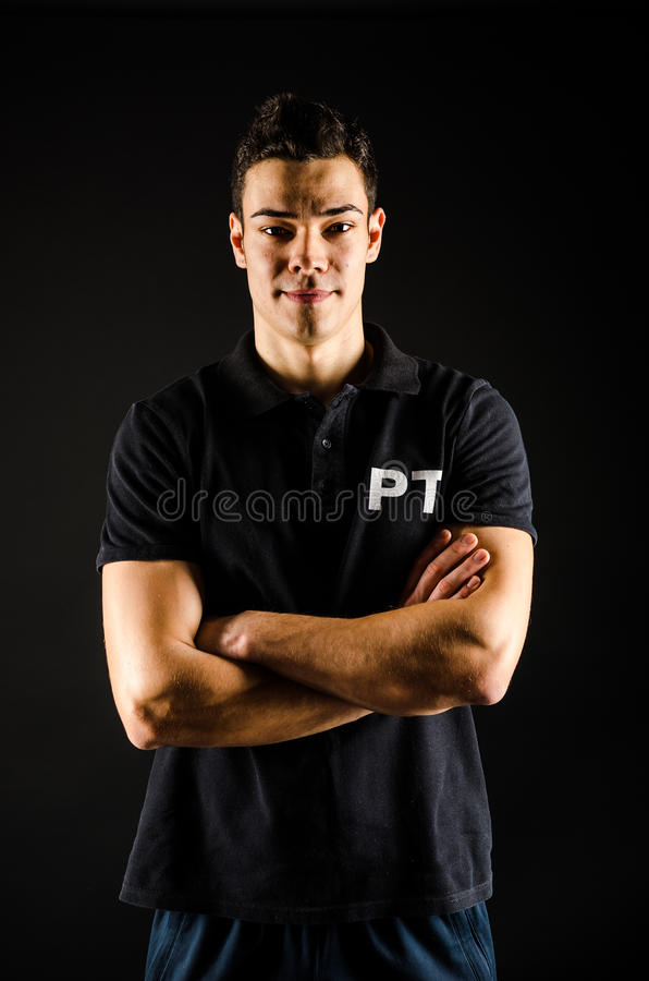 Personal Trainer. A portrait of an athletic male personal trainer royalty free stock photo