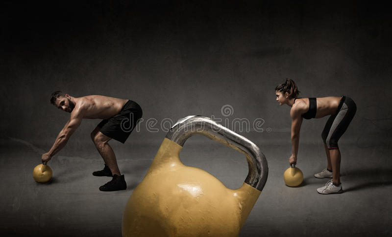 Personal trainer and student with kettleball royalty free stock images