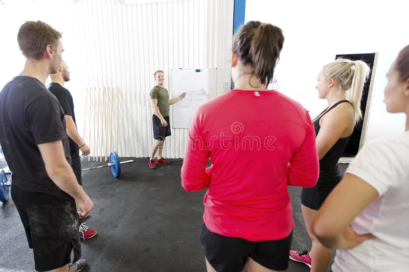 Personal trainer teaches his fitness workout team stock image