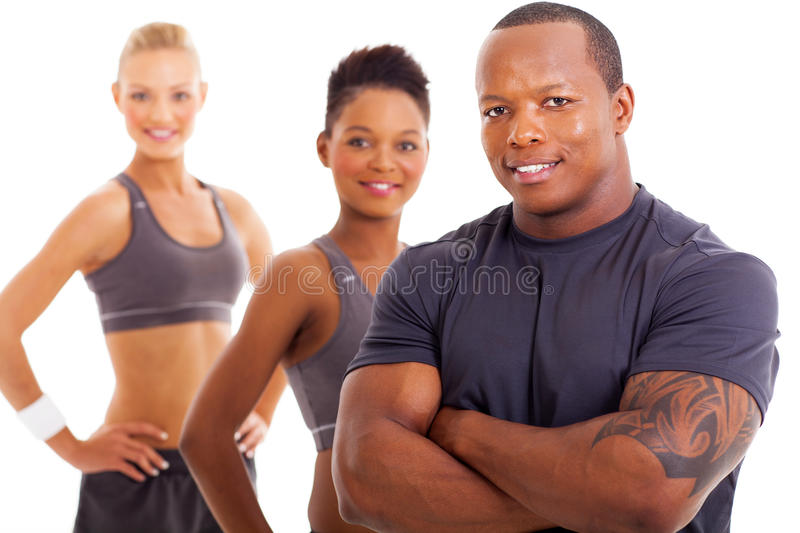 Personal trainer team. Close up portrait of handsome male personal trainer and team royalty free stock photos