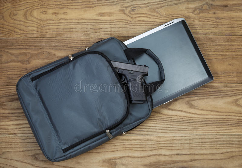 Personal Weapon With Laptop Computer And Carry Case Stock Photo