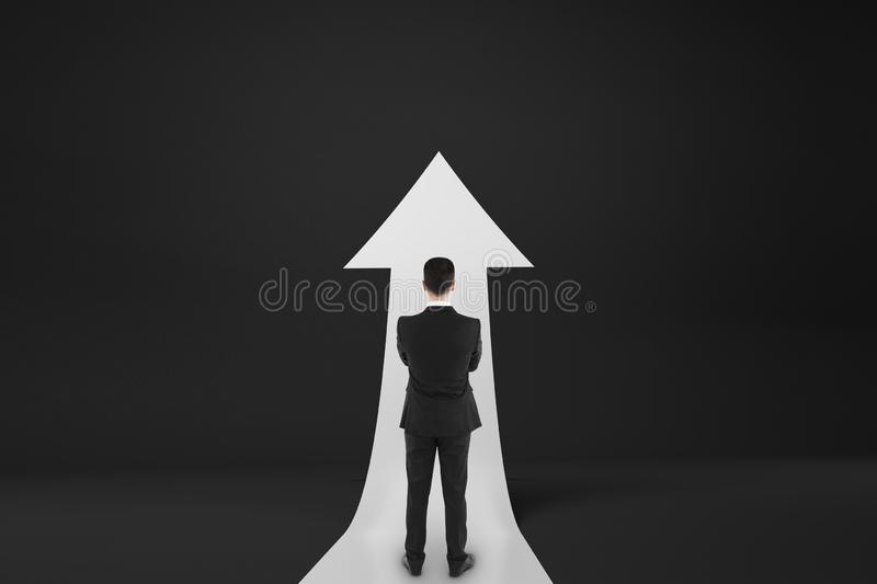Personality development concept with businessman staying midst white upward road-arrow stock photos