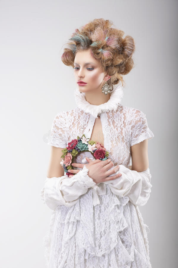 Personality. Luxurious Woman with Flowers in Evening Costume royalty free stock images