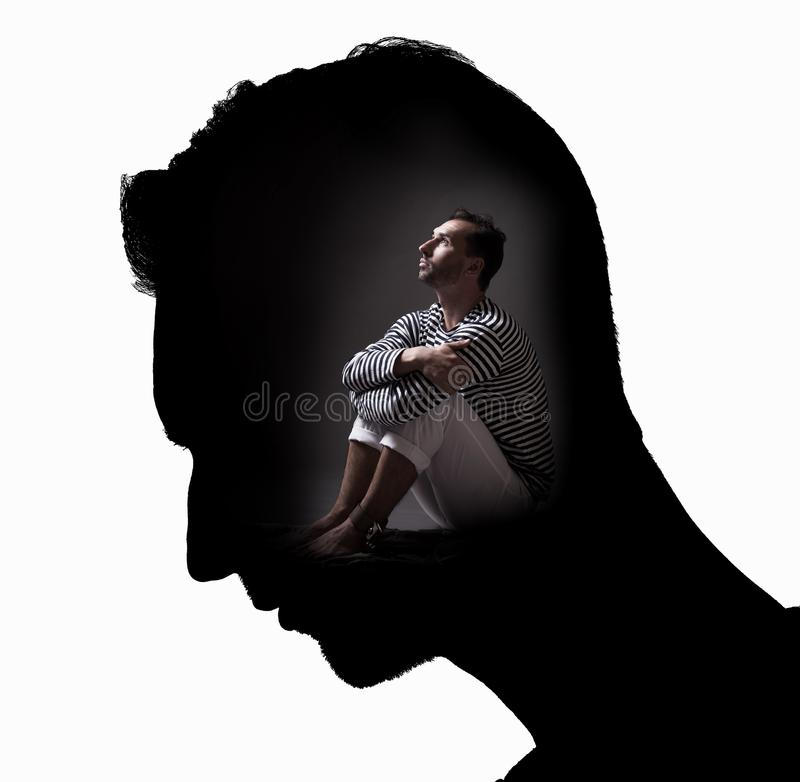Personality in prison of the mind concept. Studio portrait in white background isolated royalty free stock photo