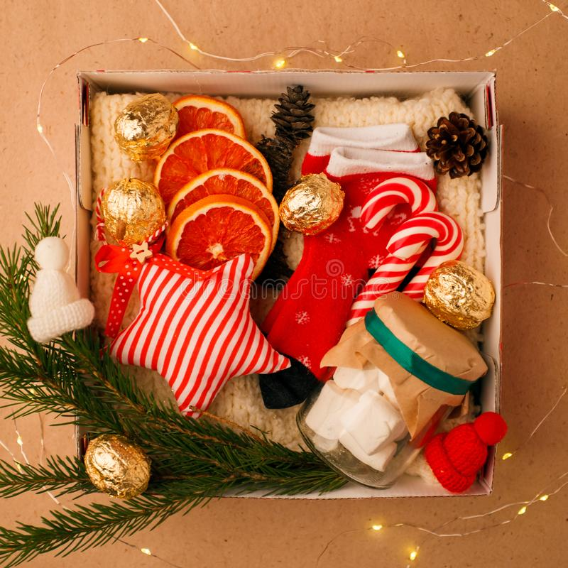 A personalized box with gifts for Christmas and New Year, a set of cute things, traditional sweets and decor stock photos