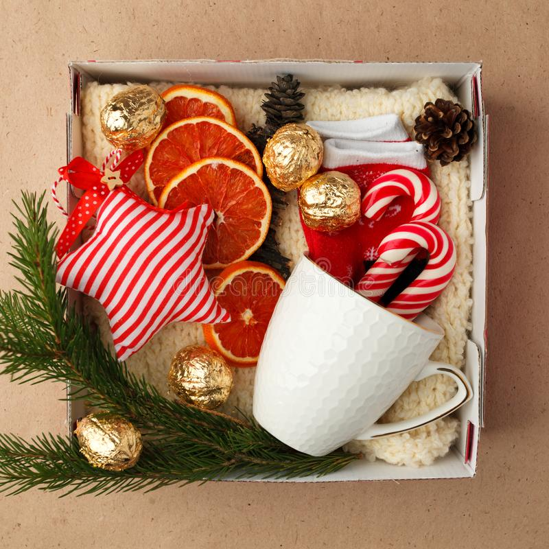 A personalized box with gifts for Christmas and New Year, a set of cute things, traditional sweets and decor stock images