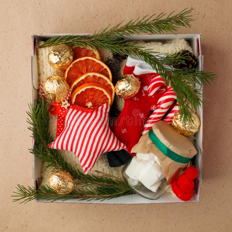 A personalized box with gifts for Christmas and New Year, a set of cute things, traditional sweets and decor stock image