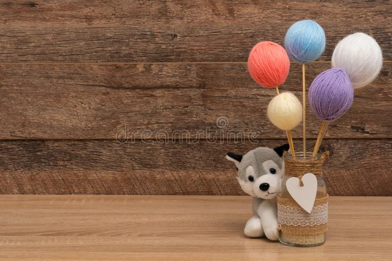 Personalized plush animal for baptism party, copyspace. Personalized plush animal for baptism party. Plush animal and a yarn balls in pastel color with large stock image