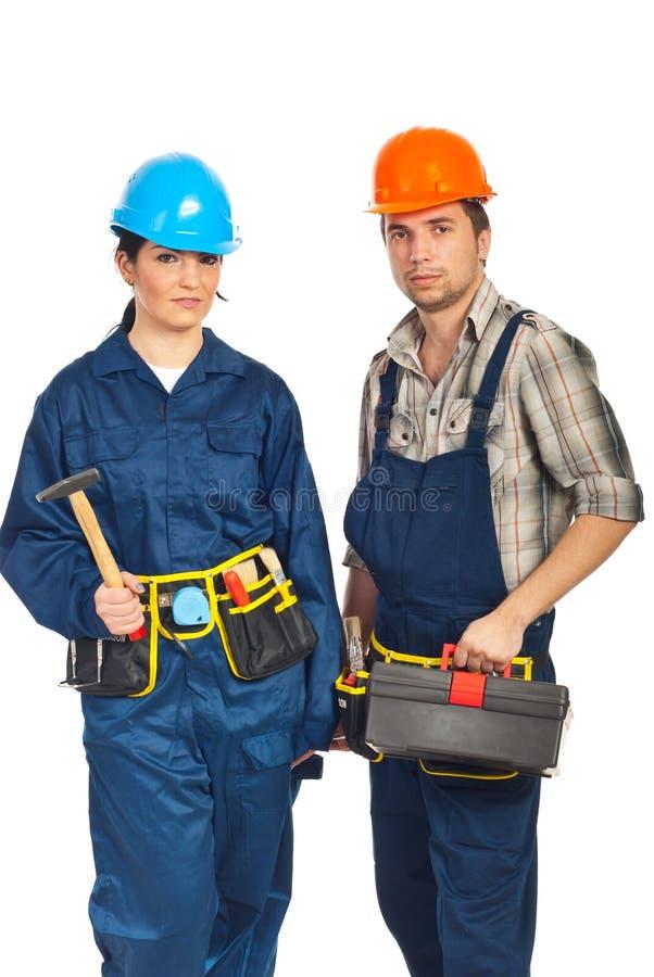 Personas de dos trabajadores del constructor fotografía de archivo