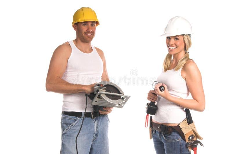 Personas de la construcción imagenes de archivo