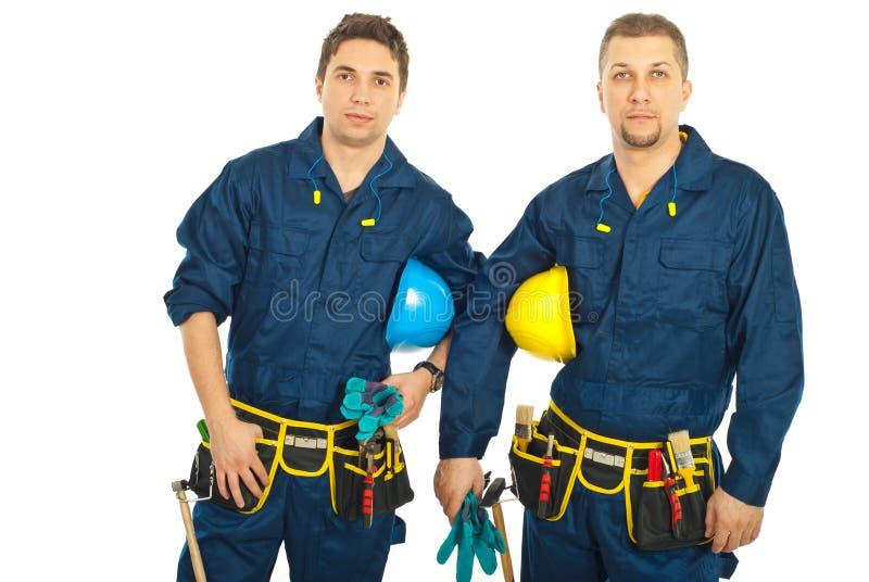 Personas hermosas de los trabajadores del constructor imagen de archivo
