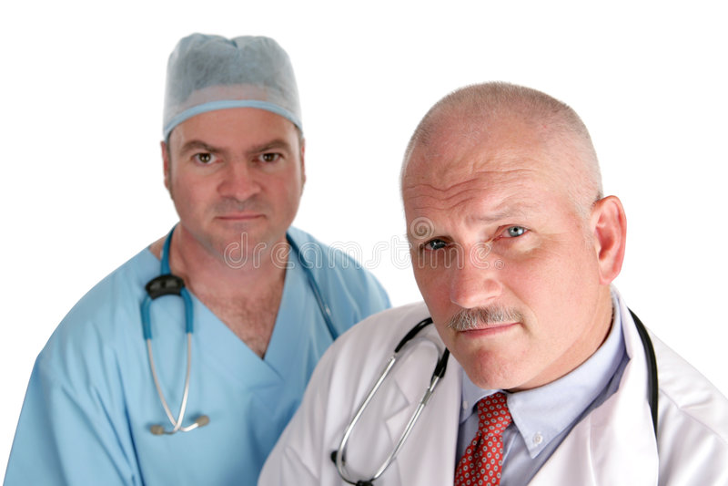 Personas médicas preocupantes imagen de archivo