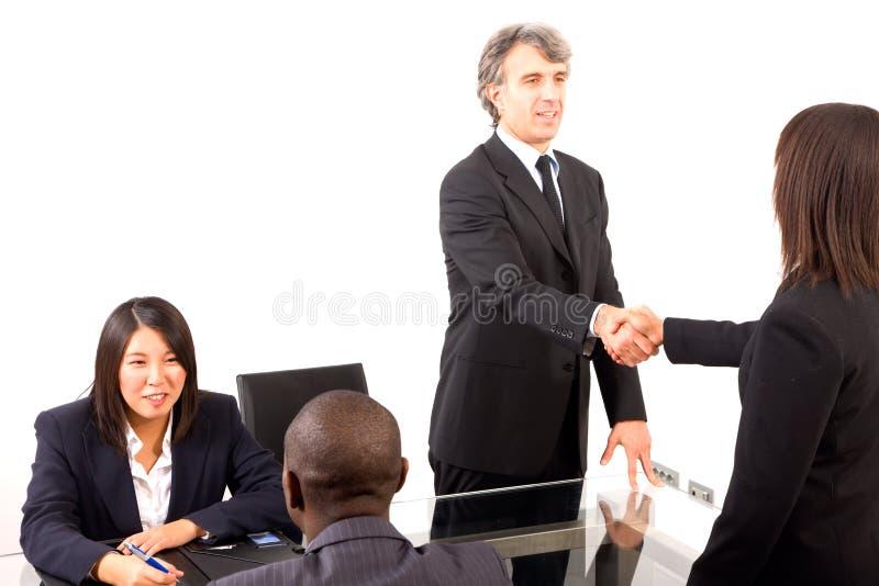 Personas Multi-ethnic durante una reunión fotos de archivo