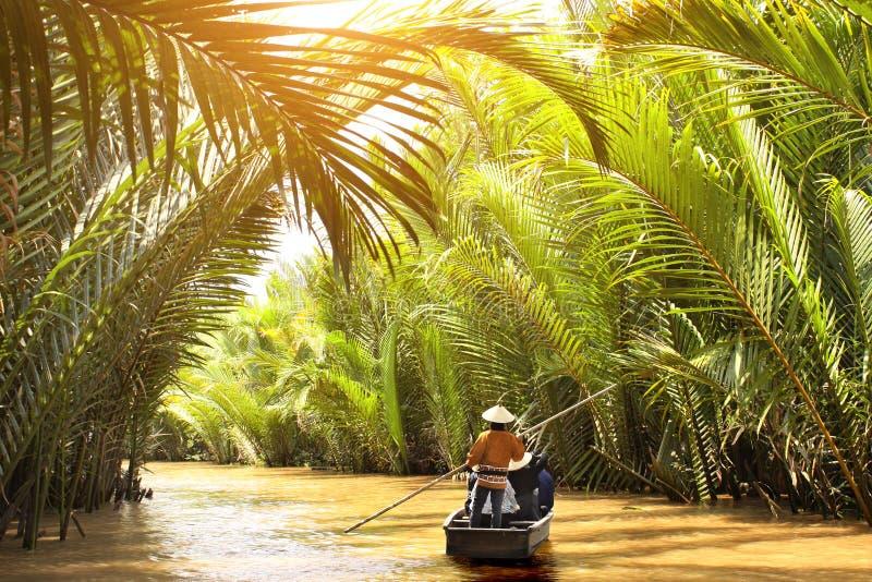 Personas navegando en el delta del río Mekong, Vietnam fotografía de archivo libre de regalías