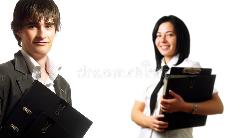 Persone di affari felici che tengono i dispositivi di piegatura fotografia stock