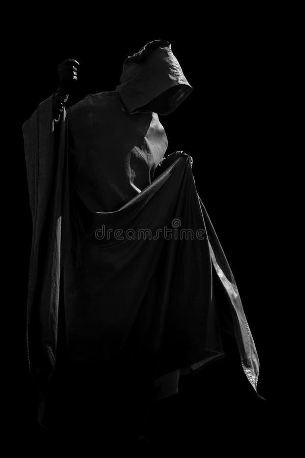 Personne dans le manteau noir photo libre de droits