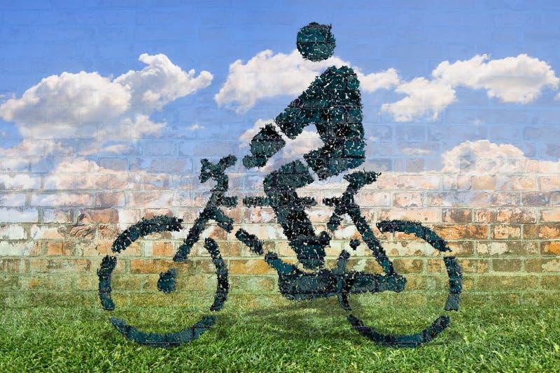 Personne faisant un cycle au-dessus d'un tapis d'herbe verte - image de concept contre images libres de droits