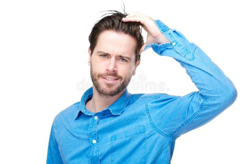 Personne masculine confuse avec la main dans les cheveux photos libres de droits