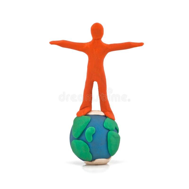 Personne retenant l'équilibre du globe images stock