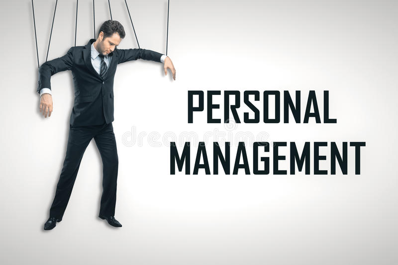 Personnel management concept. Businessman puppet on light background with text. Personnel management concept royalty free stock image