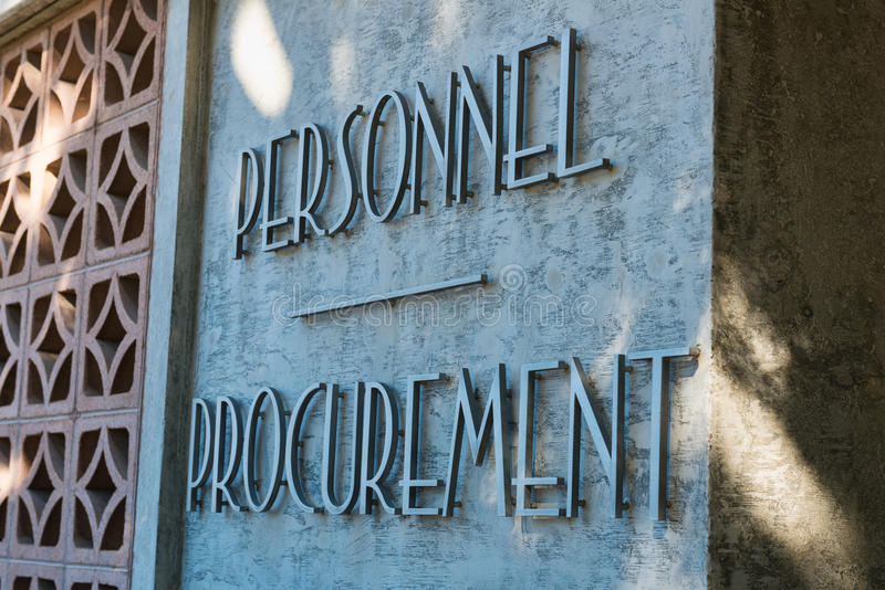 Personnel Procurement. Sign on an industrial building stock photo