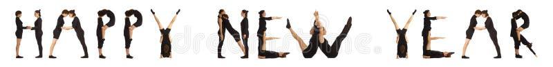 Personnes habillées par noir formant le mot de BONNE ANNÉE images libres de droits