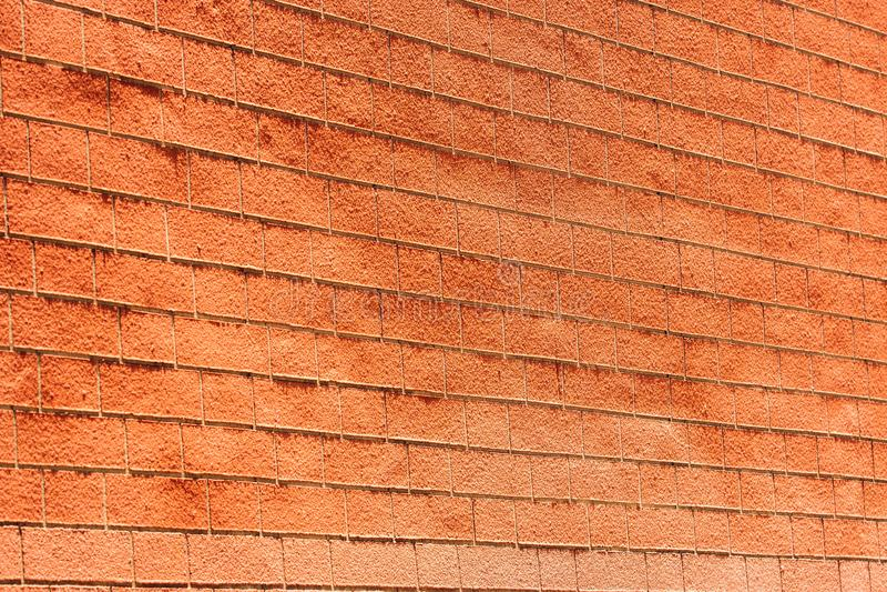 Perspectiefmening van oude rode bakstenen muur in zonlicht voor achtergrond stock afbeelding