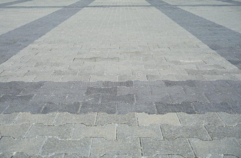 Perspectiva Visão Monotone Gray Brick Stone Pavement no Ground for Street Road Calçada, Via, Pistas, Pavimento fotografia de stock royalty free