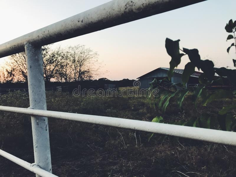 Perspective. Artsy perspective on fence with barn in background stock photography