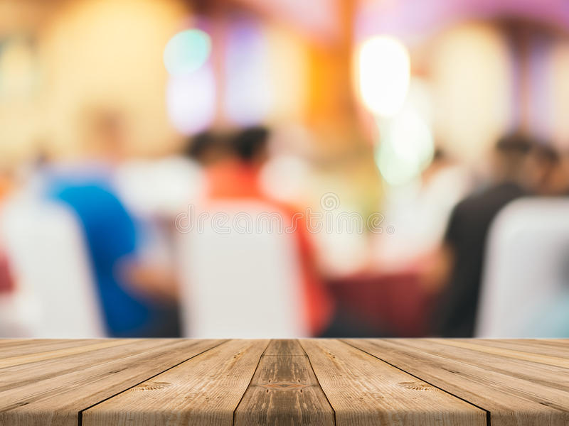 Perspective brown wood over blur in restaurant - can be used for display or montage your products. stock photos