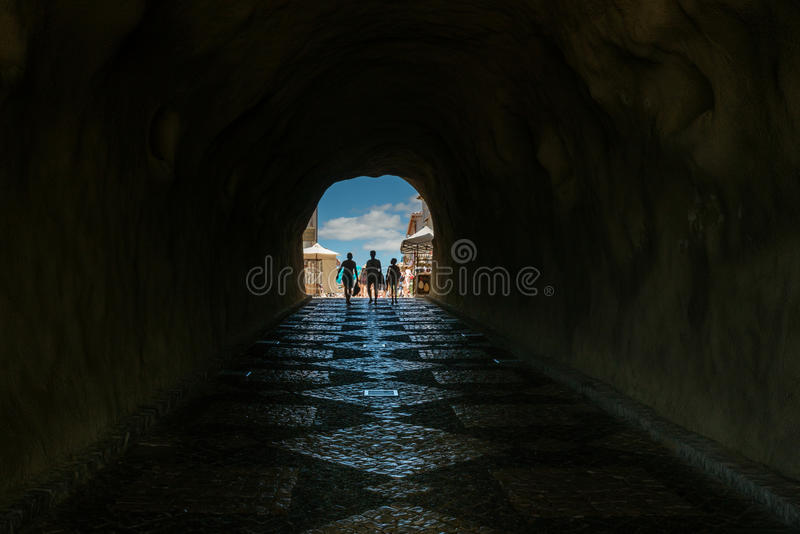 Perspective of claustrophobic underground walkway tunnel in Algarve Portugal. Perspective of claustrophobic underground walkway tunnel in Algarve Portugal stock photography