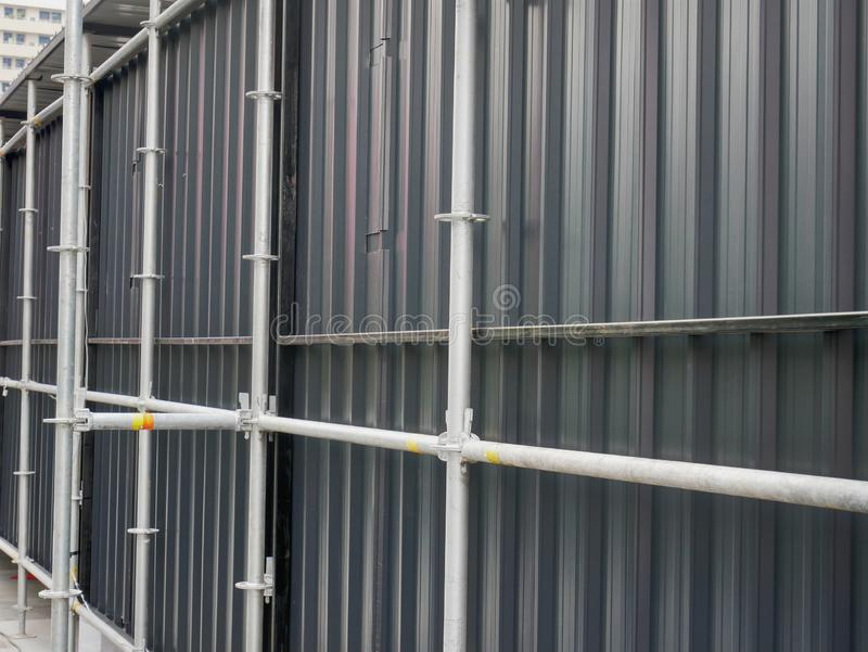 Perspective Corrugated Metal Wall and Scaffolding royalty free stock photos
