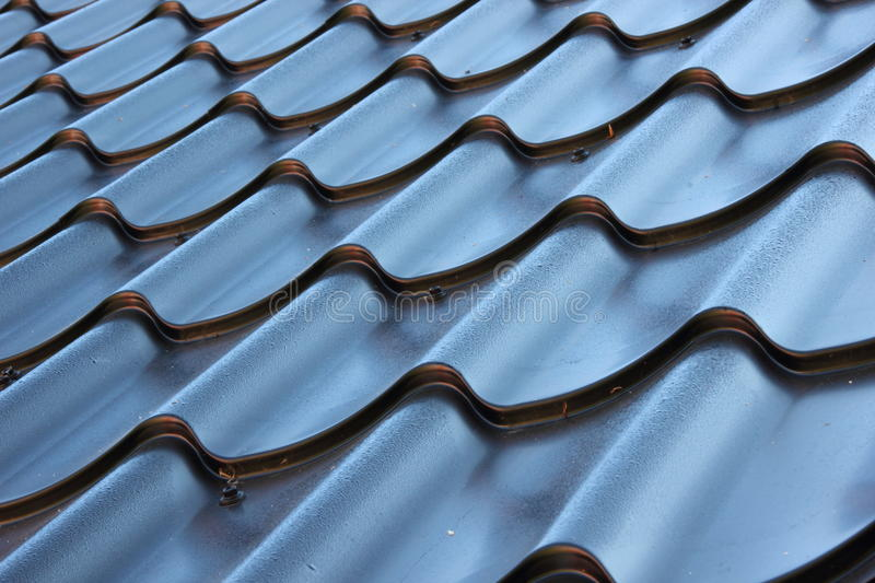 Perspective of curved black metal roof royalty free stock photo