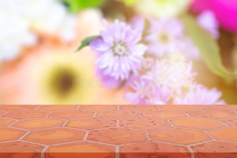 Perspective empty mon brick flooring clay brick blur flowerl background, can be used mock up for montage products display or royalty free stock photo
