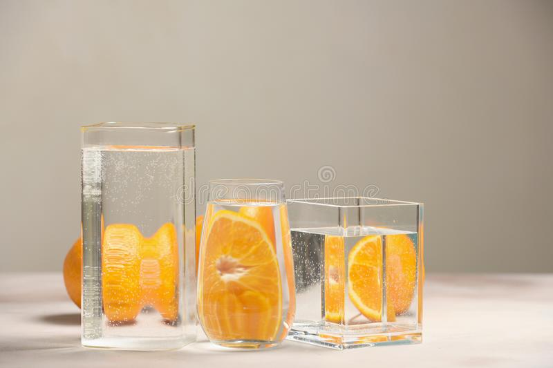 Foods distorted through liquid and glass on light background. Perspective, fractured and skewed images of common foods as seen through vessels filled with water stock image