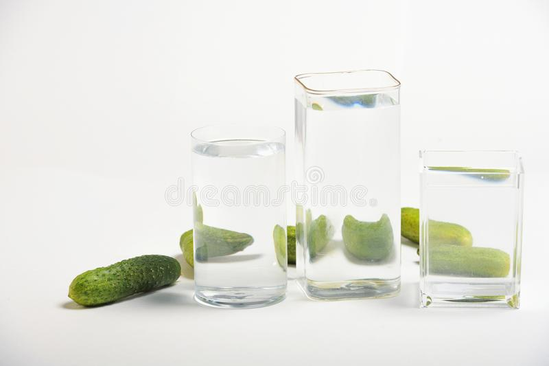 Foods distorted through liquid and glass on white background. Perspective, fractured and skewed images of common foods as seen through vessels filled with water stock photo