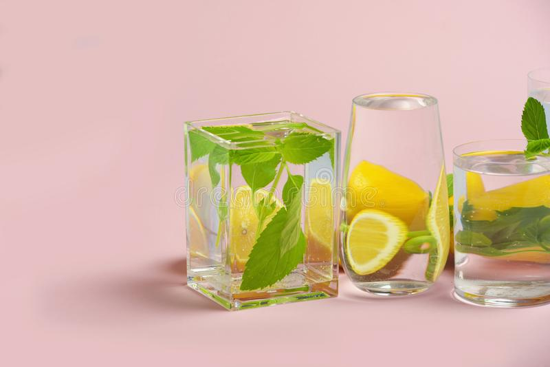Foods distorted through liquid and glass on pink background. Perspective, fractured and skewed images of common foods as seen through vessels filled with water royalty free stock image