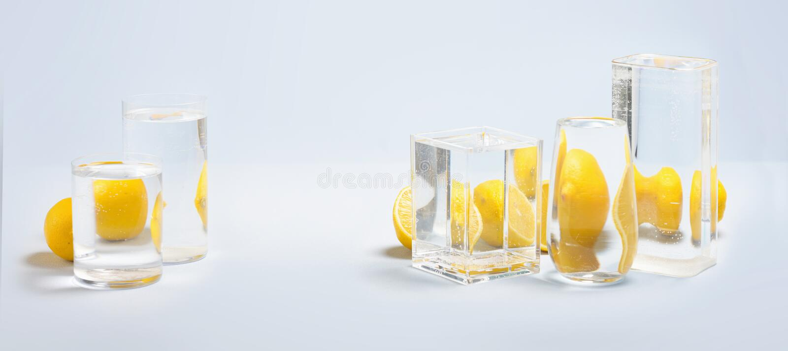 Foods distorted through liquid and glass on blue background. Perspective, fractured and skewed images of common foods as seen through vessels filled with water royalty free stock photos