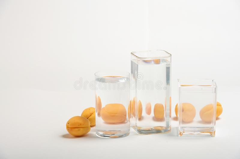 Foods distorted through liquid and glass on white background. Perspective, fractured and skewed images of common foods as seen through vessels filled with water royalty free stock photography