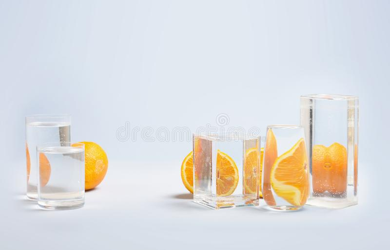 Foods distorted through liquid and glass on blue background. Perspective, fractured and skewed images of common foods as seen through vessels filled with water royalty free stock photo