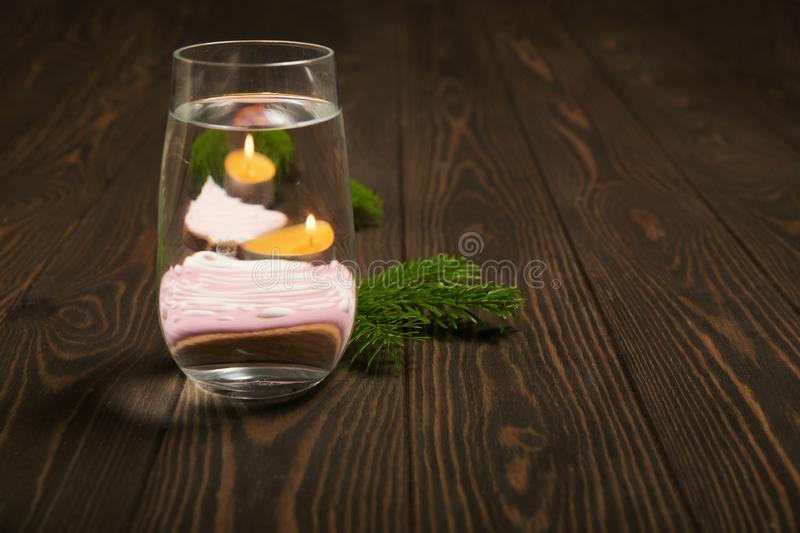 Foods distorted through liquid and glass on dark wooden background. Perspective, fractured and skewed images of common foods as seen through vessels filled with royalty free stock image