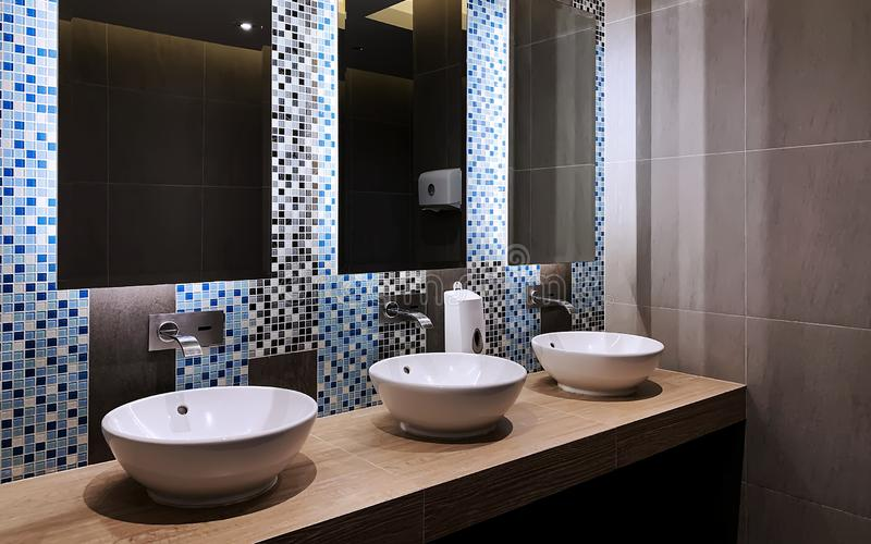 Perspective of hand wash bar. With mirror glass and wash basins in a restroom stock photo